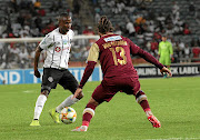 Thembinkosi Lorch  of Orlando  Pirates, left, tries to weave his way past Marc van Heerden of Stellenbosch during Saturday's Telkom Knockout first round, which Bucs won 1-0, thanks to Lorch's goal.