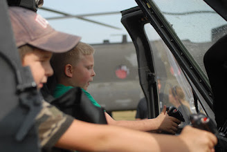 Photo: Children play in the pilots seats of a UH-60 Blackhawk helicopter.
