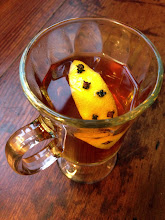 Photo: Chamomile Honey Hot Toddy:  Whiskey, chamomile honey simple syrup, hot water, lemon with cloves.