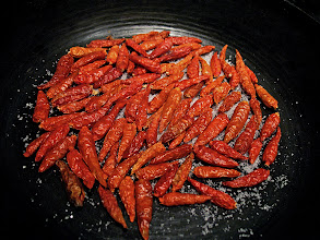 Photo: toasting dried Thai chillies for hot-and-sour sauce