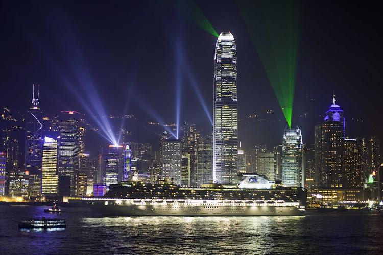 Diamond Princess in light-filled Hong Kong at night.