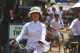 Photo: School girl riding home