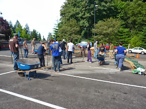 "Photo: ""Depave"" volunteers removed and haul away the asphalt. We did some outreach on this day, too."