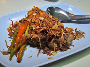 "Photo: crispy fried sour fish (""pla som"") topped with fried shallots"