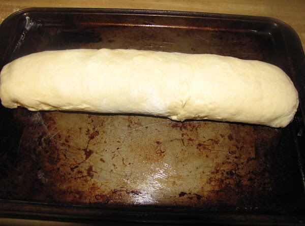 Roll out the biscuit dough to an oblong shape about 1/4 inch thick. Spread...