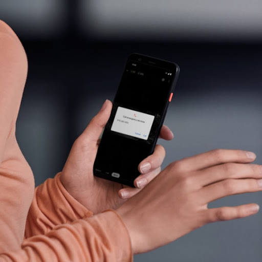 A person uses the Google Home app on their phone to call for an emergency.