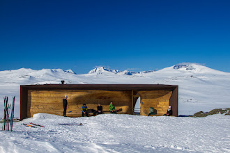 Photo: The viewpoint pavilion at Hjerkinn in the Dovre mountains, opened in 2011, offers a fantastic view of Snøhetta (the peak to the right) and the surrounding mountains. The pavilion was designed by the famous Norwegian architectural firm Snøhetta (yes, they have the taken their name from this mountain!), who are the architects behind large projects like Oslo Opera House, the Library in Alexandria and the National September 11 Memorial and Museum in New York. The Viewpoint pavilion is open during the summer season, and requires a 20 minute walk to get there.