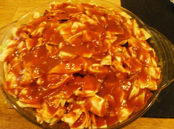 Top with cabbage and pour remaining sauce on top.