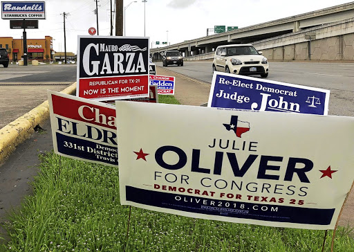 Political campaign signs outside a polling station in Austin, Texas, on March 5 2018, ahead of the first statewide US primary. Picture: REUTERS