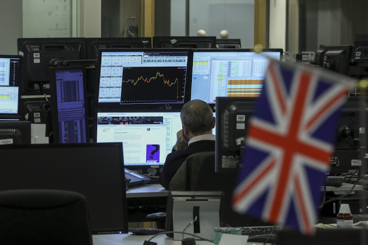 A trader monitors a graph showing the pound moving on the trading floor at ETX Capital in the UK on January 29 2019. Picture: BLOOMBERG/SIMON DAWSON