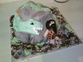 Photo: A tarzan - dinosaur cake complete with grass and rocks