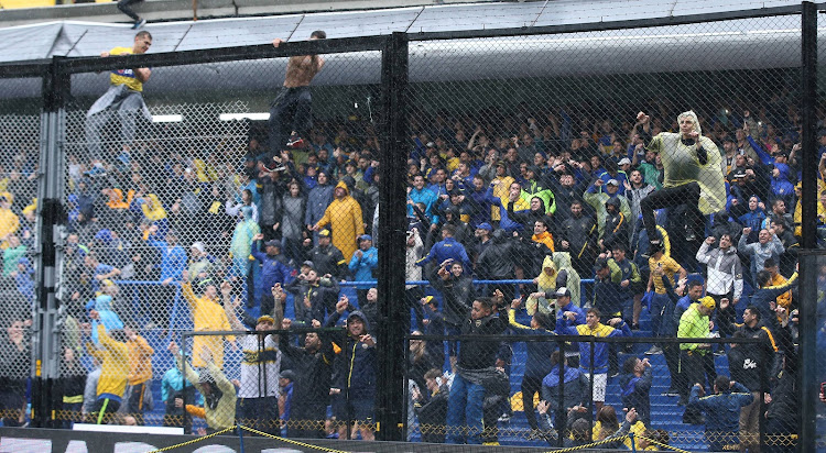Boca Juniors fans inside the stadium after the match between Boca Juniors v River Plate was suspended at Alberto J. Armando Stadium, Buenos Aires, Argentina.