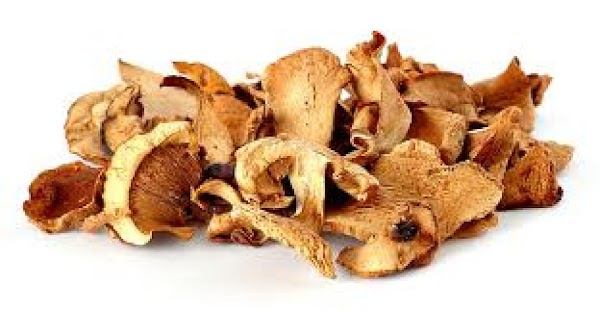 Soak dried wild mushrooms in hot vegetable stock for an hour. Strain, save liquid...