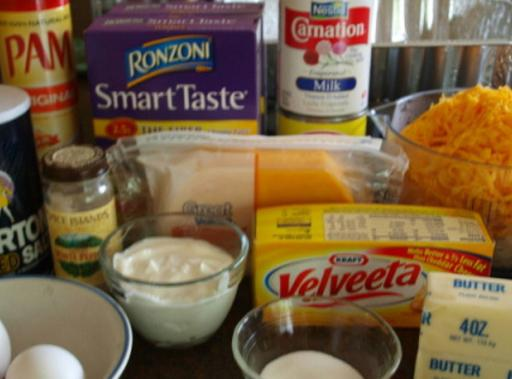 Cheese, pasta and other ingredients on a counter.