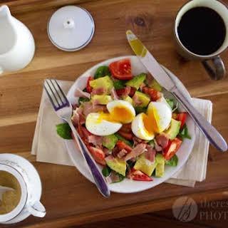 Avocado, Prosciutto, and Tomato Breakfast Salad With Soft Boiled Eggs.