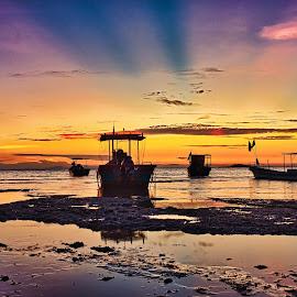 Rays by Adrian Choo - Transportation Boats ( dan, sunrise, beach, boats, rays, colours )