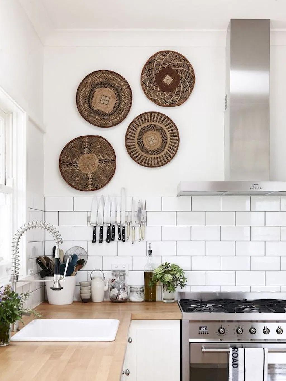 boho minimalist kitchen with woven wall decor, white subway tile backsplash and wood countertops