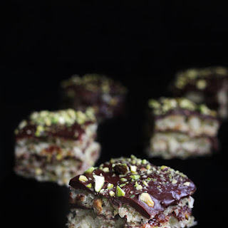 Recipe for Coconut Macaroon Cake with pistachios and coconut ganache.