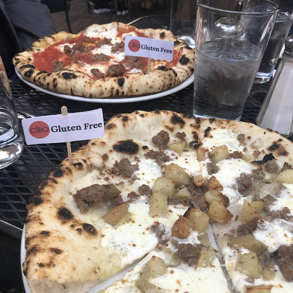 A delicious white pizza with roasted potatoes and GF sausage. And the sausage with red sauce is equally good.