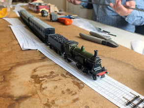 """Photo: 002 Richard Preece who is well known amongst 7mm scale NG modellers showed his other side this time and brought along a bare baseboard which he spend the day building a 14.2mm gauge 3mm scale layout onto it. Here is a very nice (albeit st-*+^=d ga*""""ge) LSWR train. At least it wasn't a Hornby RTR or Thomas set……! ( switch on smiley ) ."""