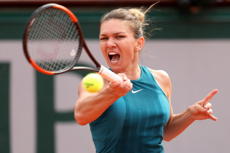 Simona Halep of Romania plays a forehand during the ladies singles final against Sloane Stephens of The United States during day fourteen of the 2018 French Open at Roland Garros on June 9, 2018 in Paris, France.