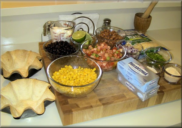Layer one - combine Pinto Beans, 4 ounces of Cream Cheese and about 2...