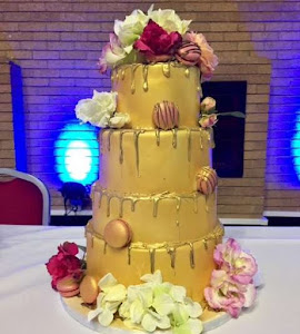 Gold drip 4 tiered wedding cake