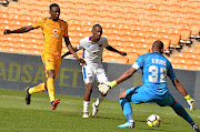 Thabo Rakhale, middle, passes Erick Mathoho and Itumeleng Khune  of Chiefs to score for Chippa United at the weekend.