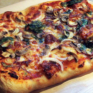 Spinach Onion Mushroom Garlic and Provolone Pizza.