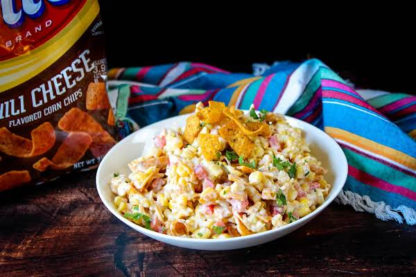 A Large Bowl Of Frito Corn Salad.