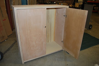 Photo: 2 door Sing Wood Chest styled Honeycomb Armoire. Lifetime structural guarantee. Northwest Cedar with a natural Eucalyptus inlay and Birch sides. This beautiful lightweight sandwich panels makes our Armoire a great storage chest that is easy to transport, move. Built with the strongest lightweight Eco-Friendly furniture ever invented, guaranteed!