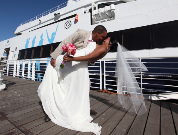 Graticia Langley and Randall Ricardo Koen, one of the ten couples who tied the knot during the 12th annual mass Valentine's Day wedding ceremony, pose for photos at the Garrison Church on Robben Island on February 14, 2012 in Cape Town, South Africa.