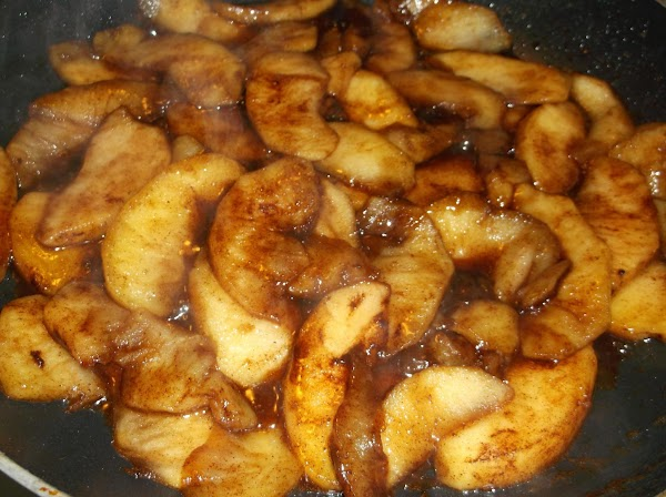 In a large skillet, melt butter over medium heat. Add sliced apples and cook,...