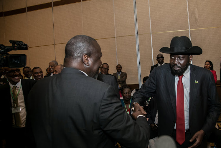 South Sudan President Salva Kiir (R) greets South Sudan Rebel leader Riek Machar during the 32nd Extra-Ordinary Summit of IGAD Assembly of Heads of State and Government in Addis Ababa, Ethiopia June 21, 2018.