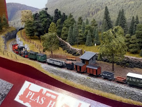 Photo: 131 A longer distance view of the Hunslet double header down goods train passing Plas Halt. Plas Halt is a real location on the Festiniog, below Tan y Bwlch, an absolutely ideal location for this type of diorama layout as it has curved cuttings at each end and a small stone embankment in front of the halt, making it also ideal for photographing the trains. An inspired choice for any Festiniog enthusiast with relatively limited space for a layout .