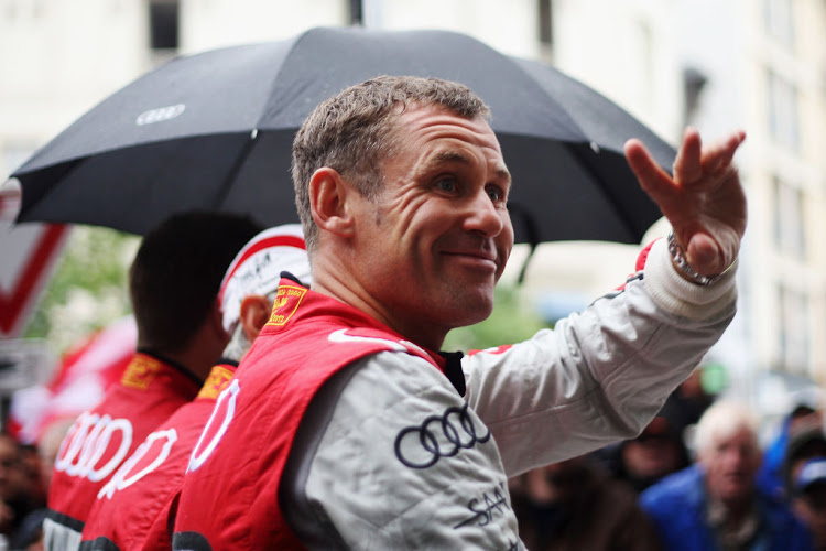 Tom Kristensen of Denmark and Audi Sport E-Tron Quattro attends the drivers' parade during previews for the Le Mans 24 Hour race on June 15 2012 in Le Mans, France.