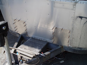 Photo: The holes where the old battery boxes were have had patches made and held in place with aircraft cleco fasteners