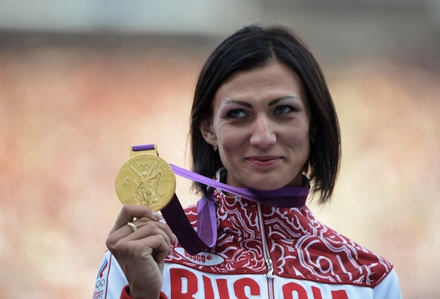 Photo: Russia's gold medalist Natalya Antyukh poses on the podium of the women's 400 hurdles at the athletics event of the London 2012 Olympic Games on August 9, 2012