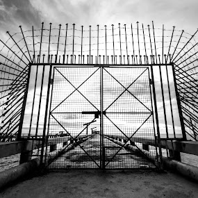Restricted by Tanawat Pontchour - Buildings & Architecture Bridges & Suspended Structures ( barb, monochrome, criminals, black and white, threat, terror, security system, penitentiary, barbed wire, captive, security, protect, war, military, army, danger, barrier, fearful, border, detention, protection, control, defense, territorial, thorn, restricted, barbed, terrified, jail, dangerous, gate, fence, restricted area, prison, prohibited, crime, defend, horror, forbidden, fear )