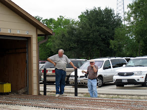 Photo: Charles Williams talking steam with a visitor.    HALS 2009-0919
