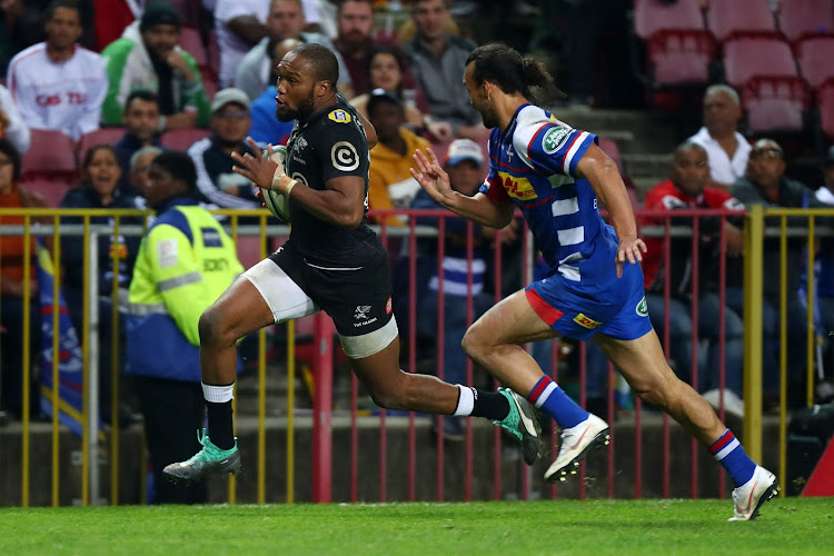 Lukhanyo Am of the Sharks gets away from Dillyn Leyds of the Stormers during a Super Rugby match at Newlands Stadium, Cape Town on July 7 2018.