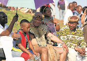President Jacob Zuma with his children Snqumo and Thandisile during the wedding of his eldest son, Edward, at the family homestead in Nkandla at the weekend. The president's brother Mike Zuma is seated on the right.