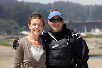 Photo: Lydia and Jeff Enjoying the warmth on the beach - great for cheering supporters and determined competitors alike.