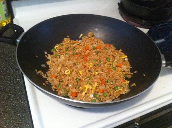 Stir rice together with vegetables, season with ginger and soy sauce to taste and...