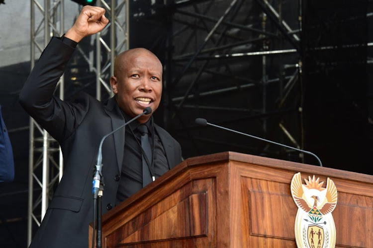 EFF leader Julius Malema speaks at the funeral service of the late struggle stalwart Winnie Madikizela-Mandela at Orlando Stadium in Soweto.
