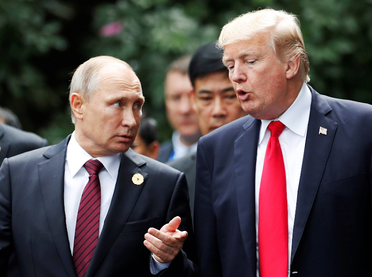 U.S. President Donald Trump and Russia's President Vladimir Putin talk during the family photo session at the APEC Summit in Danang, Vietnam. Image: REUTERS/Jorge Silva