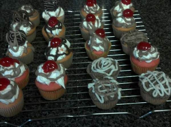 Chocolate Cupcakes With White Chocolate Cherry Icing And Chocolate All Over..