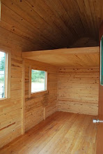 Photo: Tiny House loft for storage--The whole house is made of honeycomb panels.