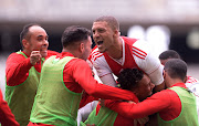 Ajax Cape Town players celebrate after winning a match. The Urban Warriors are on a mission to gain promotion.
