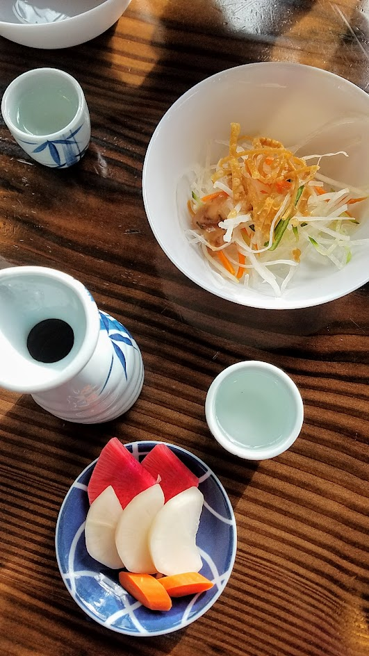 Marukin Ramen side (also available at happy hour) of light shredded daikon salad with ume plum vinaigrette and nukazuke, or Japanese pickled vegetables